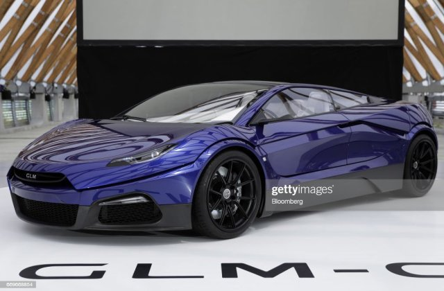 The Glm Co G4 Concept Electric Vehicle Stands On Display - Medium