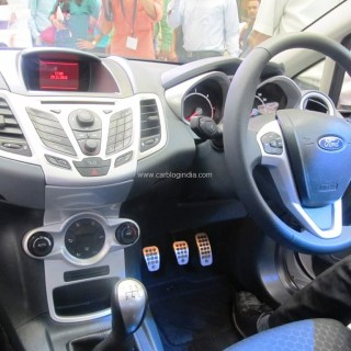 confused between new ford fiesta 2011 and hyundai verna india photos in
