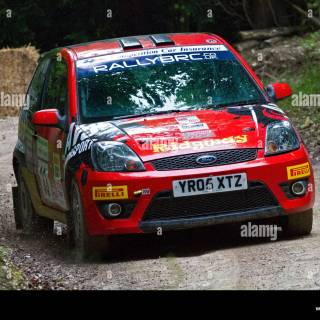 2005 ford fiesta st with driver gethin jones on the rally photo - small