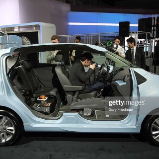 looking at the interior of chevrolet spark ev which photo